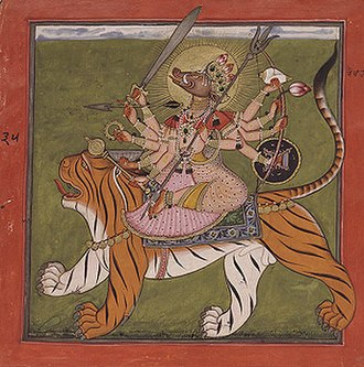 Varahi - Varahi seated on a tiger. Varahi is sow-faced and ten-armed.