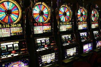 """Slot machine - A row of """"Wheel of Fortune"""" slot machines in a casino in Las Vegas. This specific slot machine is themed to the TV game show Wheel of Fortune."""