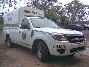 Law enforcement in Panama - Ford pick-up truck; note the back installation for carrying officers or suspects.