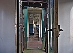 View inside the abandoned SNCB B22490 type-K3 carriage from B22495 in As, Belgium (DSCF3124-hdr).jpg