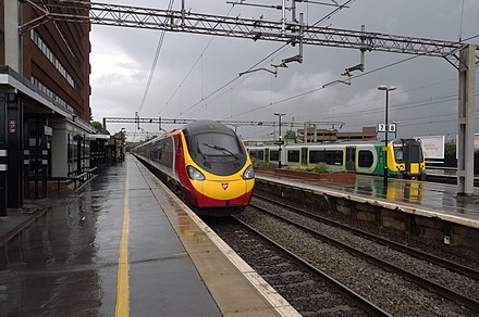 Fast and slow lines at Watford Junction: a Virgin Trains Euston-Wolverhampton service & a London Midland stopping service Watford Junction railway station MMB 20 390045 350252.jpg