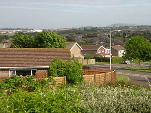 Southill, Weymouth - A view over Radipole Lake towards Weymouth town centre (on the left) and Portland (on the right) from Southill. In the foreground is the original caretaker's bungalow of the primary school.