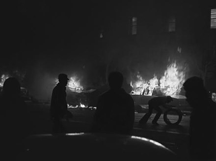 Rioters causing property damage at the Civic Center Plaza. Burning police cruisers are seen in the background. Image credit: Daniel Nicoletta. White Night riots.jpg