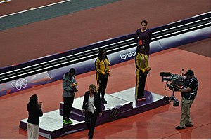 Athletics at the 2012 Summer Olympics – Women's 100 metres - Image: Womens 100 m medal ceremony 2012 Olympics