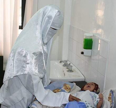 A Yemeni doctor examines an infant in a USAID-sponsored health care clinic Yemeni doctor.jpg