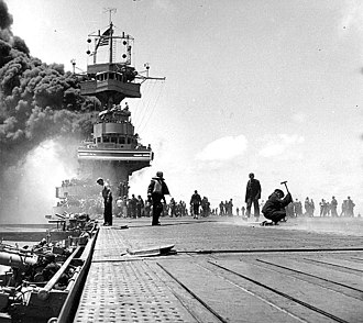 USS Yorktown (CV-5) - Smoke pours from Yorktown after being hit in the boilers by Japanese dive bombers at Midway.