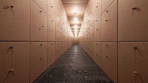 Zimoun - 318 prepared dc-motors, cork balls, cardboard boxes 100x100x100cm⎢Zimoun 2013. Installation view: Opernwerkstätten Berlin, Germany.