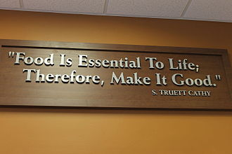 "S. Truett Cathy - ""Food Is Essential to Life"", says Truett Cathy on sign in Chick-fil-A in San Antonio, Texas"