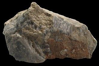 Åkermanite - Åkermanite (yellowish brown), calcite (blue), foshagite (hillebrandite variety, fibrous), tilleyite (creamy)