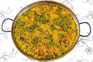 Trade and use of saffron - Saffron is one of three key ingredients in paella valenciana