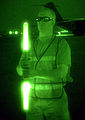 070730-F-4576W-310 Staff Sgt. Jacob Whetstone holds a pair of marshalling sticks July 30 at Baghdad International Airport in Iraq.jpg