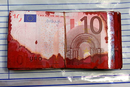 Banknotes from an ATM robbery made unusable with red paint 10 euro notes from an ATM robbery.jpg