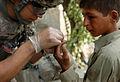 10th Mountain medic treats Afghan boy DVIDS186375.jpg