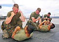 130528-N-QD718-085 PHILIPPINE SEA (May 28, 2013)- Marines assigned to Fleet Anti-terrorism Security Team Pacific (FASTPAC), perform mixed martial arts training techniques aboard U.S. 7th Fleet 130528-N-QD718-085.jpg