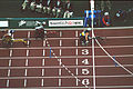 141100 - Athletics wheelchair racing Louise Sauvage finish line - 3b - 2000 Sydney race photo.jpg
