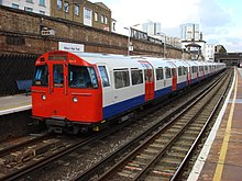 A Bakerloo Line train departs Willesden Junction railway station, bound for Elephant and Castle. The trains are so low the platform is actually a step UP.