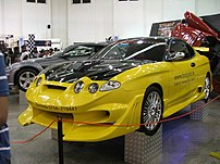 Hyundai Coupe/Tiburon with body kit at Ceylinc...