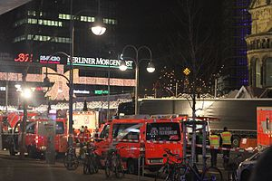 2016 Berlin attack - The truck involved, surrounded by emergency vehicles