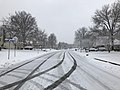 2018-03-21 09 58 51 View southwest along a snow-covered Kinross Circle (Virginia State Route 6651) at Stone Heather Drive (Virginia State Route 7283) in the Chantilly Highlands section of Oak Hill, Fairfax County, Virginia.jpg