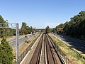 2018-10-23 13 16 28 View east along Interstate 66 and the Orange Line of the Washington Metro from the overpass for Barbour Road (Virginia State Route 2793) in Idylwood, Fairfax County, Virginia.jpg