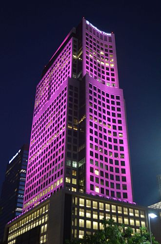 Brickell World Plaza - The building lights up at night in a variety of colors.