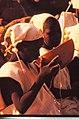 ASC Leiden - W.E.A. van Beek Collection - Dogon markets 28 - A circumcized boy drinking at the market. Tireli, Mali 1990.jpg