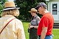 A Park Ranger with visitors. (79b6ec23-3ea9-48c3-a4a2-7c552093f28d).jpg