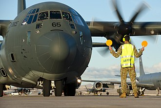 No. 285 Squadron RAAF - Image: A Royal Australian air force aircraft maintainer marshals an RAAF C 130J Super Hercules into position after a training mission during Red Flag 15 1