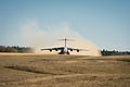 A U.S. Air Force C-17 Globemaster III aircraft departs Geronimo Landing Zone during the Joint Readiness Training Center 14-03 field training exercise at Fort Polk, La., Jan. 16, 2014 140116-F-XL333-165.jpg