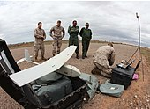 A U.S. Marine, right, with the 24th Marine Expeditionary Unit prepares an RQ-11B Raven unmanned aerial system for a demonstration flight for members of the Royal Moroccan Armed Forces in support of exercise 120411-M-FR139-051.jpg