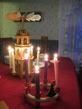 Christmas and holiday season - An Advent wreath and Christmas pyramid adorn a dining table.
