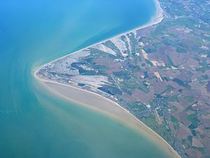 Lydd - Aerial view of Lydd with the airfield in the centre of the photograph