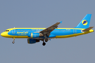Aerosvit Airlines - An Airbus A320 on short final to Dubai International Airport in 2013.