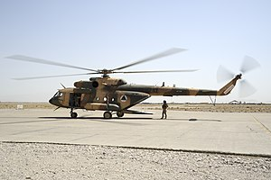 Shindand Air Base - An Afghan Air Force Mi-17 helicopter sits on the ramp at Shindand Air Base in 2011.