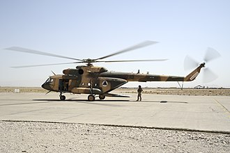 Herat Province - An Afghan Air Force Mi-17 helicopter sits on the ramp at Shindand Air Base in 2011.