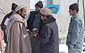 Afghan Uniformed Police officers talk with local Afghan citizens at the front gate of the police station near the Sayed Abad district center, Wardak province, Afghanistan, Feb 120213-A-BZ540-029.jpg
