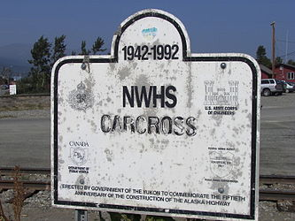 Alaska Highway 50th anniversary sign in Carcross, Yukon.jpg