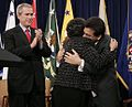 Alberto Gonzales embraces own mother (2005-02-14).jpg