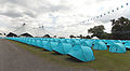 Aldenham Country Park event campsite field with tents and bunting, and Kayam tent.jpg