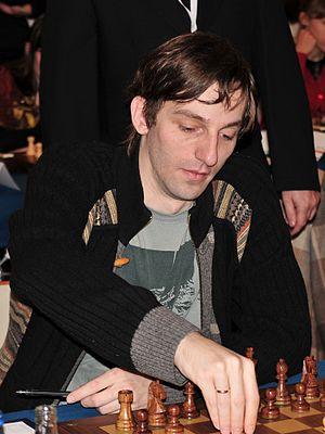 Alexander Grischuk - Alexander Grischuk makes a move in the European Chess Team Championship, Warsaw, 2013