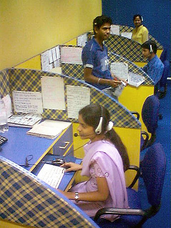 Offshore outsourcing of jobs, such as this call centre in India, significantly increased during the decade as many multinational corporations moved their manufacturing and services from western countries to developing countries. An Indian call center.jpg