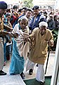 An elderly couple arriving for cast their vote in the Madhya Pradesh Assembly Election, in Bhopal on November 25, 2013.jpg
