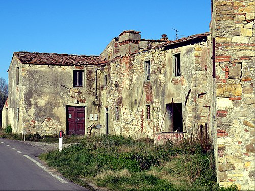 Ancient abandoned country house.jpg