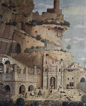 St. Sebastian (Mantegna) - Detail of the antique city in the background of the Louvre St. Sebastian. The classical ruins are typical of Mantegna's pictures. The cliffy path, the gravel and the caves are references to the difficulties of reaching the Celestial Jerusalem, the fortified city depicted on the top of the mountain, at the upper right corner of the picture, and described in Chapter 21 of John's Book of Revelation.
