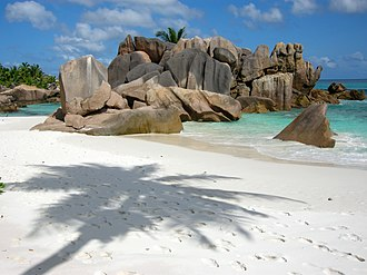 "Tourism in Seychelles - The beach of ""Anse Cocos"", La Digue."