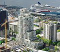 Apartment building in Belltown with cruise ship in background - Seattle.jpg