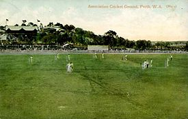 An early coloured image of the Association ground in about 1910, looking north, with a large crowd watching a game in progress. Note the the original 1890s stand is evidently packed.