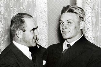 Wrestling at the 1936 Summer Olympics - Estonians August Neo (left) and Kristjan Palusalu won medals in both wrestling styles at the 1936 Olympics