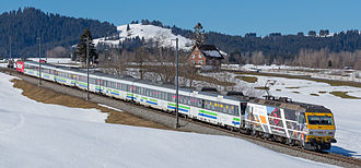 Voralpen Express - Voralpen-Express with Re 456 head and tail pulling out of Biberbrugg railway station towards Rothenthurm
