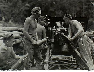 Battle of Pearl Ridge - Australian artillerymen fire a 25 pounder from Pearl Ridge, March 1945